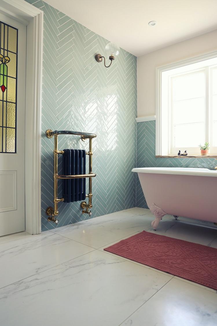 pink bathtub in elegant bathroom
