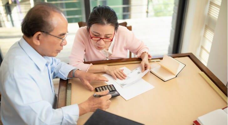 Couple prepares their taxes